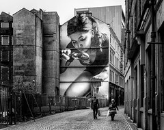 Choose your friends carefully. (Mister G.C.) Tags: street people urban blackandwhite bw white black building monochrome painting scotland alley mural europe image glasgow candid streetphotography alleyway 20mm unposed juxtaposition forcedperspective sidestreet pancakelens primelens sonyalpha mitchellstreet mirrorless strassenfotografie sel20f28 sonya6000 mistergc