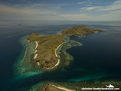 aerial of the dive site 'The Cauldron' and Gili Lawa Laut island - Komodo, Indonesia-1 (Christian Loader Photography) Tags: ocean sea sky terrain cloud flores water coral indonesia landscape island islands boat scenery yacht scenic surface aerial land tropical remote reef komodo coralreef drone diveboat phantom3 komodonationalpark aerialimage christianloader djiphantom3professional