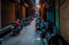 Full of bikes... (Syahrel Azha Hashim) Tags: street travel light vacation india holiday detail building alley nikon colorful dof getaway streetphotography naturallight tokina motorcycle handheld shallow moment 16mm olddelhi ultrawideangle busystreet pc9 d300s syahrel