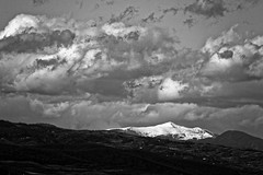 Road to Nehoiu (Adi Berger Photo) Tags: sky blackandwhite bw snow mountains clouds zoom romania buzau nehoiu panasonicfz1000