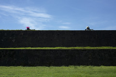 Courting in Sri Lanka (Photosightfaces) Tags: umbrella couple sitting fort couples lovers sri lanka together srilanka galle courting lankan rampart