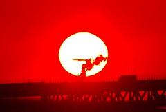 Airplane across the sunrise (usotuki) Tags: sunrise airplane dawn smoke landing      yokohamabaybridge    portofyokohama  osanbashiyokohamainternationalpassengerterminal pentaxk7 sigma50500mm1463apodg keihinindustrialsash