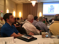 """Chris Morden and Ed Smallwood look on as day 2 begins at the district conference.Photo credits: Erik GrunwaldMore information: <a href=""""http://northraleighrotary.org/2016-district-conference"""" rel=""""nofollow"""">northraleighrotary.org/2016-district-conference</a>"""
