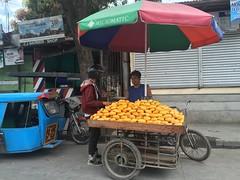 """Yes, mangoes make you smile."" (Ron27ald) Tags: street food fruits umbrella philippines mango nik iphone metromanila"