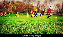 Uploaded to Stockimo (oohay!) Tags: girls playing game grass children football soccer match pitch players footie stockimo