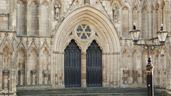 York Minster Outer Doors and Stonework (Gilli8888) Tags: york light building church stone architecture streetlight doors cathedral stonework yorkshire religion arches doorway yorkminster minster portals entranceway entrances