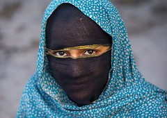 bandari woman with face covered at the panjshambe bazar thursday market, Hormozgan, Minab, Iran (Eric Lafforgue) Tags: portrait people woman beautiful beauty face fashion horizontal scarf religious outdoors photography eyes women asia veiled veil mask iran market muslim islam religion hijab culture persia headshot womenonly hidden covered iranian bazaar adultsonly cultural oneperson traditionaldress customs middleeastern frontview sunni 20sadult youngadultwoman balouch hormozgan onewomanonly lookingatcamera  bandari  1people  iro thursdaymarket  minab colourpicture  panjshambe panjshambebazar iran034i2860 boregheh