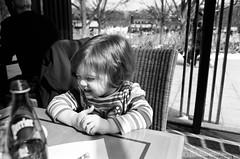 giggles (september.) Tags: winter light blackandwhite bw film 35mm washingtondc daughter sunny rae canonae1 sculpturegarden kodakbw400cn nationalgalleryofart 2yearold canonfd50mmf14 canonfd