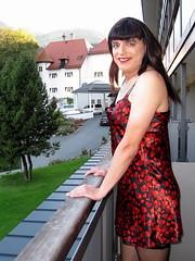 Smile (Paula Satijn) Tags: red black sexy girl hearts outside austria shiny dress balcony silk tgirl satin gurl nightdress chemise nightie