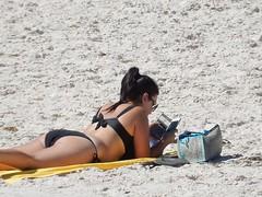 It's an e-Beach (mikecogh) Tags: woman reading device bikini thongs electronic sunbathing henleybeach