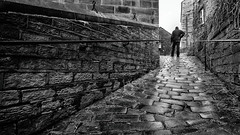 Holmfirth 2016 (S.R.Murphy) Tags: street old greatbritain england blackandwhite bw wet monochrome architecture mono downtown unitedkingdom outdoor stonework streetphotography backstreet cobbles oldstreet westyorkshire socialdocumentary holmfirth canon1740mmf4l cobbledstreet niksoftware cobbledpath canon6d stuartmurphy