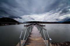 Tempestuous (John Cothron) Tags: longexposure winter sky usa cloud cold digital georgia landscape us unitedstatesofamerica gainesville scenic floating blowing stormy lakeshore thesouth dixie 15mm afternoonlight boatdock lakelanier marinabay carlzeiss tempestuous hallcounty americansouth southernregion 35mmformat 10stopneutraldensityfilter johncothron canoneos5dmkii southatlanticstates leefiltersystem cothronphotography leebigstopper zeissdistagont2815mmze johncothron img12458160224