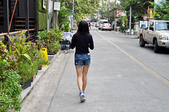 Quiet stroll (Roving I) Tags: street walking thailand bangkok longhair greenery jeansshorts trishngo