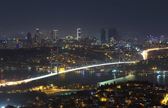 Uniting the continents (A.Keskin) Tags: city longexposure bridge night lights asia europe cityscape istanbul bosphorus amlca