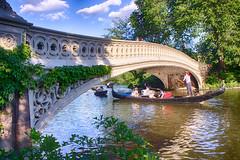 Bow Bridge Gondolier (Steve Rosenbach) Tags: park nyc newyorkcity summer lake color horizontal boat centralpark manhattan rowboat gondola gondolier bowbridge calvertvaux frederickolmsted