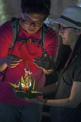 Lighting joss sticks (David Clay Photography) Tags: festival thailand sticks candle naturallight joss loy chaingmai krathong