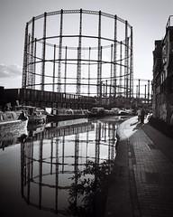 A favourite place (tripowski) Tags: blackandwhite bw reflection london mamiya water monochrome mono canal kodak regentscanal hackney 45mm towpath mamiya645 eastlondon londonfields broadwaymarket gasometer kodakplusx mamiya645protl 45mmf28c