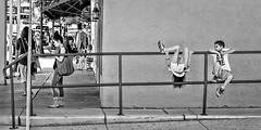 Hey Mom, Watch This! (Wes Iversen) Tags: arizona people blackandwhite monochrome kids women streetphotography fences hff smartphones nikkor18300mm fencefriday