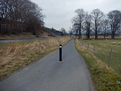 Cycleway alongside the A86, 2016 Mar 23 (Dunnock_D) Tags: road uk trees sky cloud grass forest woodland grey scotland highlands cloudy unitedkingdom britain path highland cyclepath footpath bollard kingussie cycleway badenoch