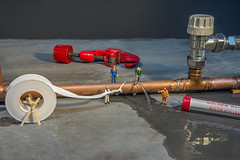 Burst Pipe (Steve, W) Tags: nikon workmen plumbing pipe models copper plumber leaking d7200