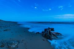 Dark Root (kevbphotography) Tags: uk sea orange beach water reflections coast suffolk sand colours tide east coastal sunet anglia covehithe