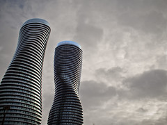 Marilyn Munroe Towers (creditflats) Tags: sky toronto canada tower marilyn architecture modern clouds pen grey moody curves gray munroe overcast twist olympus mississauga gta citycentre hirise ep5 marlyin