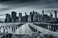 Winter in NYC (bprice0715) Tags: city nyc newyorkcity longexposure travel winter sky blackandwhite bw water skyline clouds canon buildings river outdoors cityscape skyscrapers manhattan lowermanhattan leadinglines canoneos5dmarkiii canon5dmarkiii