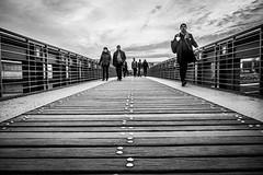 On the Way (jules_kllr) Tags: street bw white black berlin monochrome deutschland photography blackwhite sonnenuntergang himmel wolken menschen brcke holz gelnder symmetrie linien planken schwarzweis