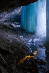 Behind the Falls (Sam Wagner Photography) Tags: park blue winter shadow cold ice minnesota frozen waterfall warm minneapolis falls cave spelunking minnehaha