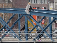 Woman sitting on Blaue Brucke (jlarsen2006) Tags: city bridge blue woman beautiful germany europe sitting medieval historic attractive heels freiburg brucke breisgau blaue