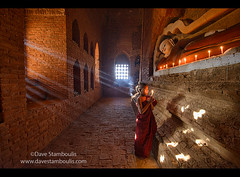 A young monk praying with rays of sunlight in the temples of Bagan, Myanmar (jitenshaman) Tags: travel light asian religious temple asia candle robe burma buddhist prayer religion pray praying monk buddhism unesco holy monks temples devotion destination myanmar burmese sanskrit pagan bagan robes novice nyaungu worldlocations