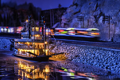 minnesota model - railroad railway train - toy river boat (Dan Anderson.) Tags: longexposure railroad light motion water colors minnesota museum night train reflections river mississippi toy lights boat miniature movement model modeltrain antique small tracks stpaul railway hobby tiny transportation riverboat locomotive steamboat twincities bluffs mn choochoo modelrailway ogauge
