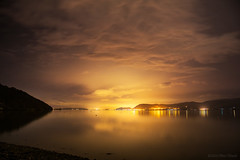 I dreamt the clouds will pass (OR_U) Tags: uk longexposure nightphotography sea reflection water wales night clouds landscape gold lights nightlights nightscape le oru menai anglesey 2016 menaistrait