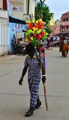 Plastic Flute vendor () Tags: india tamilnadu kumbakonam mahamaham