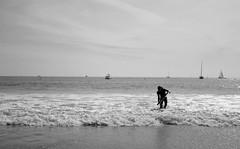 Boogie boarder (C_Kho) Tags: ocean california leica bw beach monochrome surf pacific orangecounty oc lagunabeach boogieboard leicaq