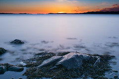 Sunset West Coast Sweden (bjrn_c) Tags: sunset sea sky orange sun water stone smooth longexpo
