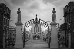 """the light was brighter (listening to """"high hopes"""", pink floyd) (jeneksmith) Tags: sky blackandwhite bw brick church monochrome cemetery graveyard metal wall clouds canon fence grey louisiana gate iron catholic cross neworleans gray statues crucifix inri nola catholicism tombs crescentcity bigeasy vaults camposanto strochs canoneos70d"""