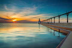 Sunset Waters (PhotoJacko - Jackie Novak) Tags: sunset sky lighthouse seascape water reflections landscape lights pier lakemichigan goldenhour washingtonpark michigancity gndfilter leefilters singhraydarylbensonreversegndfilter leend6softgndfilter