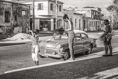 waiting for someone (Gerard Koopen) Tags: street people bw woman 35mm women waiting fuji cuba streetphotography oldtimer fujifilm bb oldcar camaguey 2016 straatfotografie waitingforsomeone xpro1 gerardkoopen