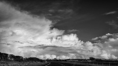 A drive in the clouds (lunaryuna (off to Iceland for 2 weeks)) Tags: road bw panorama monochrome weather wales clouds season blackwhite spring curve lunaryuna cloudscape northwales amazingclouds angleseyisland seasonalwonders