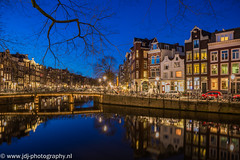 Heibrug (JdJ Photography (www.jdj-photography.nl)) Tags: city bridge trees reflection water netherlands amsterdam evening living canal bomen europa europe apartments country nederland bicycles land shops bluehour innercity brug avond singel twigs mokum continent province fietsen stad takken noordholland gracht winkels reflectie benelux wonen canalhouses grachtengordel binnenstad grachtenpanden provincie northholland appartementen amsterdamcentrum wijdeheisteeg canalbelt grootamsterdam blauweuur agglomeratie