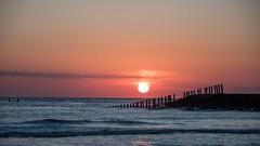 Sunset (kjeldvdh) Tags: pink blue sunset sea sky orange seascape nature netherlands silhouette outside twilight nikon day outdoor pastel nederland calm poles westkapelle d5500