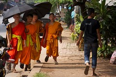 SONY2_ 037077 (andi islinger) Tags: people umbrella luangprabang streetscenes select buddhistmonk asia2012 2all2010 wmbpicall laosall laos3oct2012 sony2037077jpg
