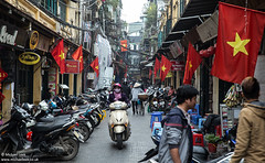 Street scene, Hanoi, Vietnam (Michael Leek Photography) Tags: street city travel architecture southeastasia vietnamese space culture streetphotography flags vietnam streettrader tet custom hanoi streetfood lunarnewyear crowded travel2016 michaelleek lunarnewyear2016 michaelleekphotography