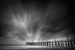 Pier and Clouds (hzeta) Tags: ocean sea sky bw costa white seascape motion black blanco mystery clouds landscape pier muelle mar long exposure y wind negro paisaje viento movimiento bn shore cielo nubes seda marino silky exposicion oceano larga misterio