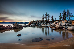 Sand Harbor Lake Tahoe. (www.sergeybidun.com) Tags: california blue winter sunset red snow mountains reflection tree water clouds forest rocks nevada laketahoe sandharbor sergeybidun