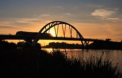 Walfridis bridge.... (powerfocusfotografie) Tags: bridge sunset holland water backlight train canal crossing traffic silhouettes railway groningen henk trainbridge vanstarkenborghkanaal nikond90 powerfocusfotografie