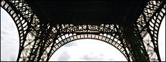 Eiffel arches (Thompson Photography) Tags: trip paris march eiffeltower latoureiffel 1998 398 scancafe41113