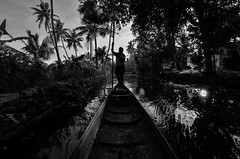 Josephkutty taking us to the Vembanad through the surreal backwaters. (parmeetkohli) Tags: mist fish mountains coffee trek peace tea country lakes culture kerala jungle gods own toddy kathakali