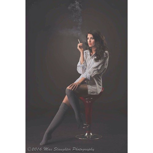 Lovely Liberty relaxing, having a smoke, and looking gorgeous! Notice the long legs on this six foot beauty. #brunette #beauty #gorgeous #sexy #longlegs #smoking #magnificent #cigarettesmoke #stunning #beautiful #shorts #studio #nikon #d800